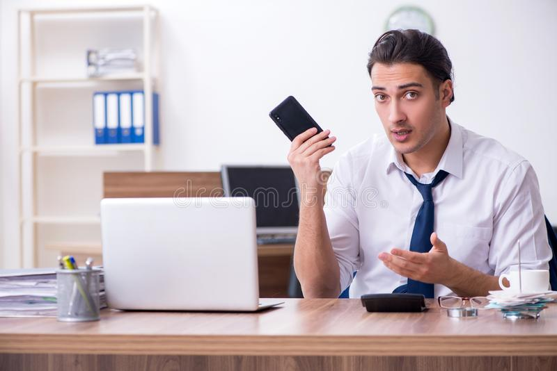 Young male businessman working in the office stock images