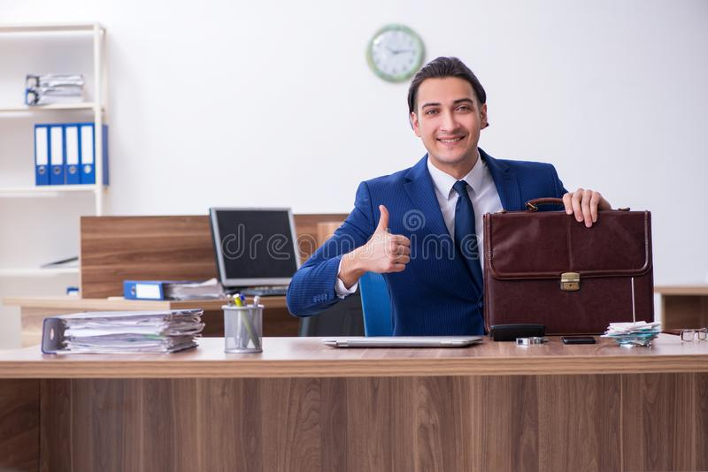 Young male businessman working in the office stock photo