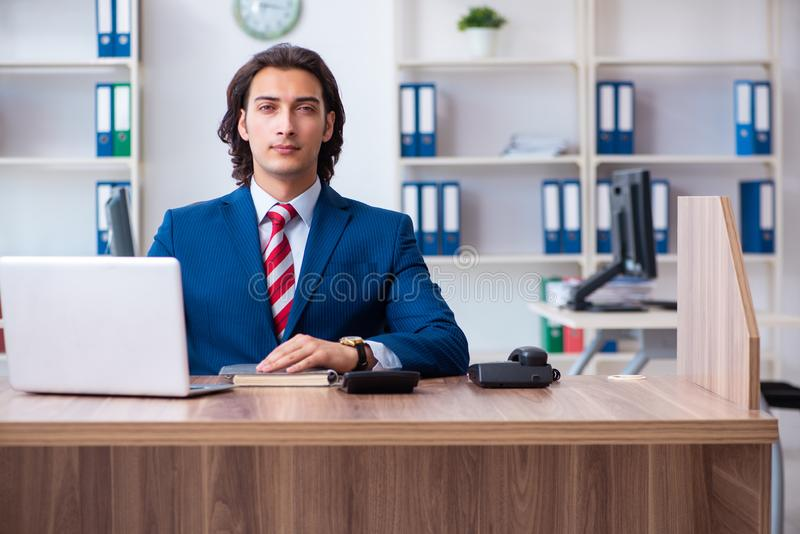 Young male businessman working in the office stock photos