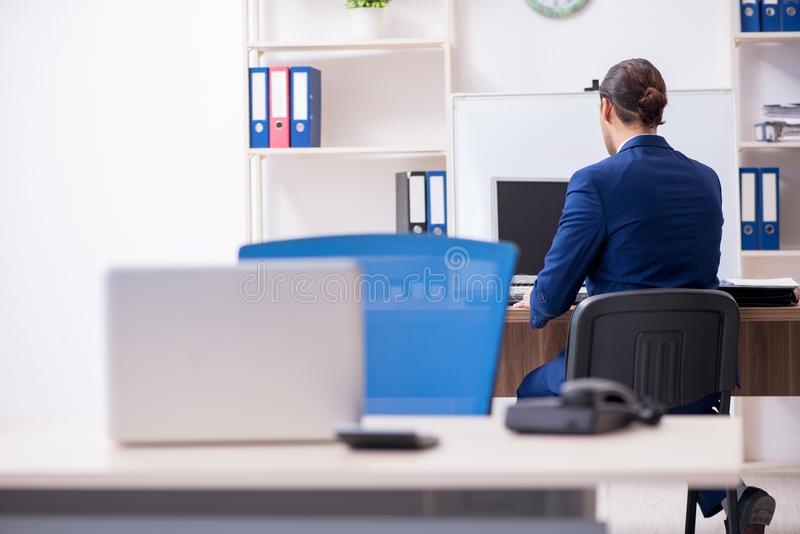 Young male businessman working in the office royalty free stock images