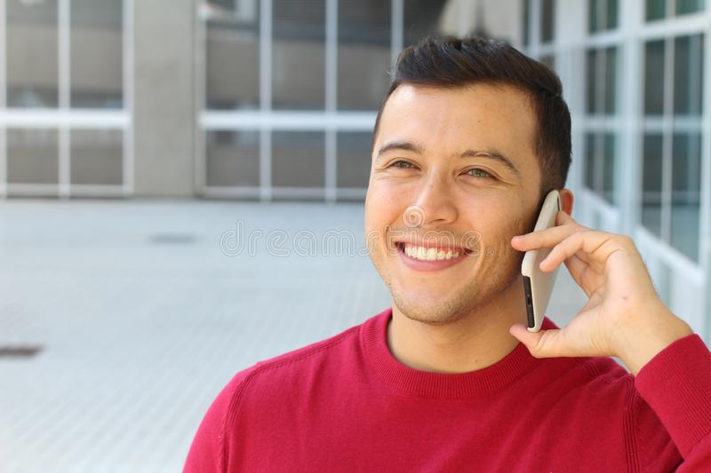 Young male calling by phone outdoors stock images