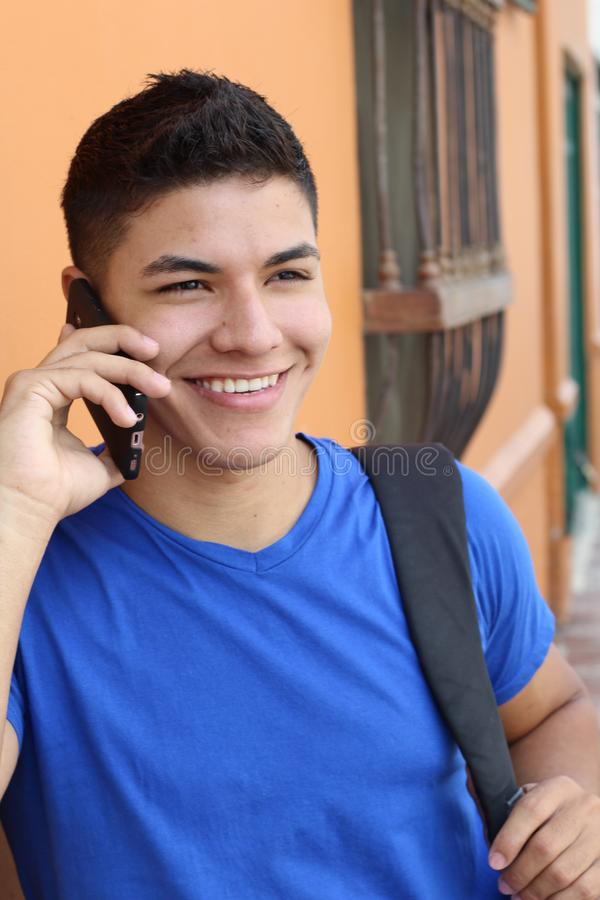 Young male calling by phone outdoors royalty free stock image
