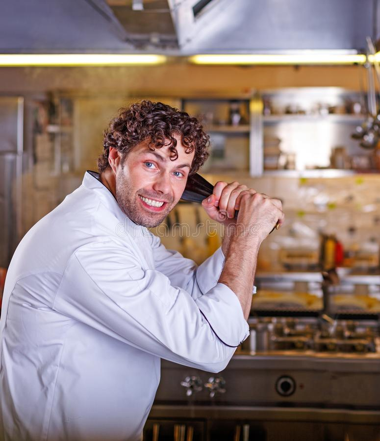 Chef fighting in the kitchen. Cooking process concept. stock photo