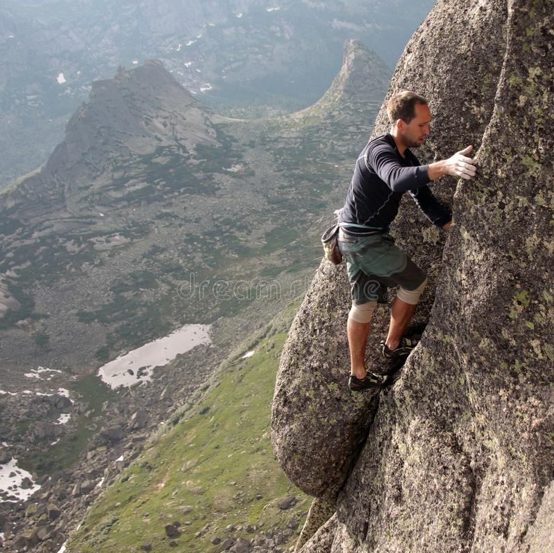 Athletic Man Climbing On The Mountain Rock Stock Photo - Image Of Hill, Blue 93161524-7990