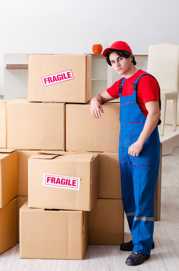Young male contractor with boxes working indoors. The young male contractor with boxes working indoors royalty free stock photo