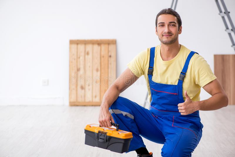 Young male contractor working indoors. The young male contractor working indoors royalty free stock image