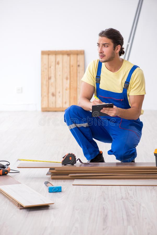 Young male contractor working indoors. The young male contractor working indoors royalty free stock images