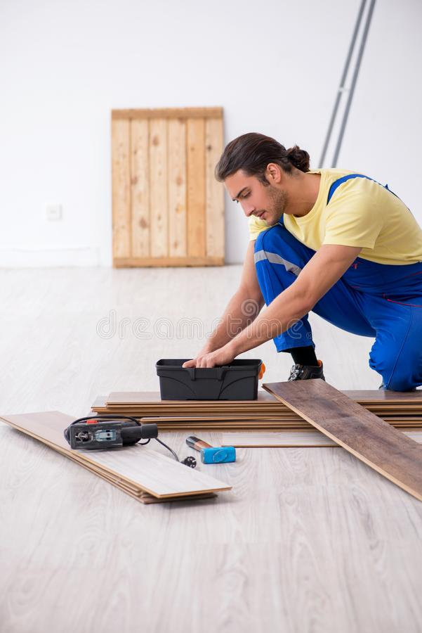 Young male contractor working indoors. The young male contractor working indoors stock photo
