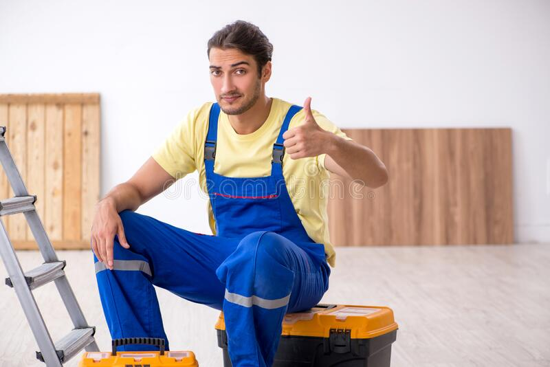 Young male contractor working indoors royalty free stock image