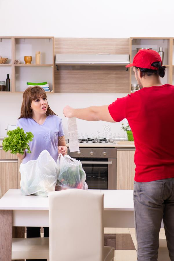The young male courier in food delivery concept royalty free stock photos