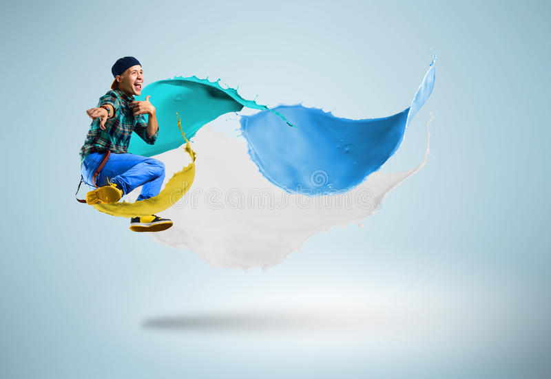 Young male dancer jumping with splash of paint. Young male dancer jumping surrounded by splashes of paint stock photos