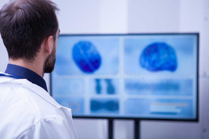 Young male doctor checking his patient brain after surgery. Doctor in hospital stock photos