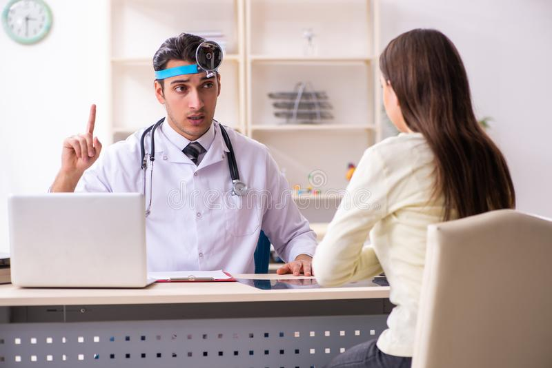Young male doctor and female beautiful patient royalty free stock images