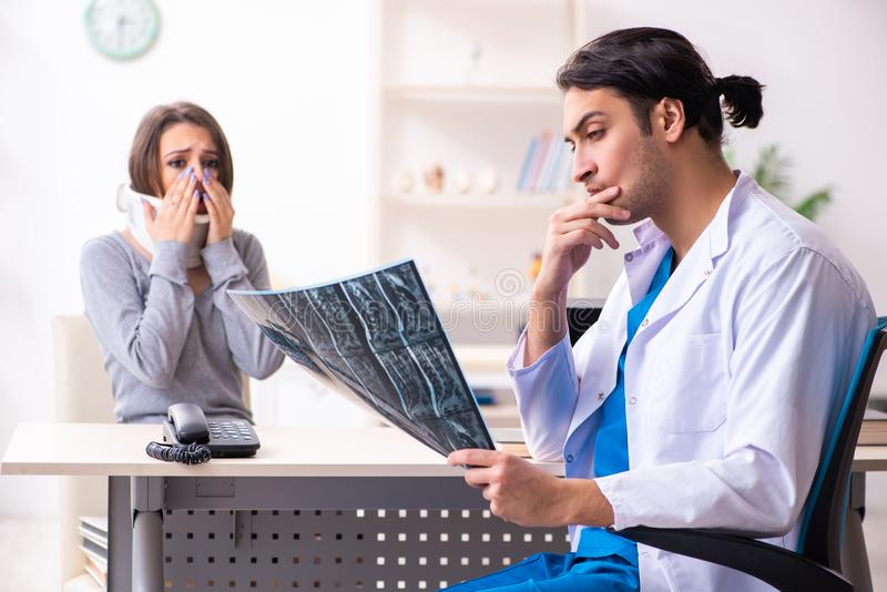 Young male doctor and female beautiful patient stock photos