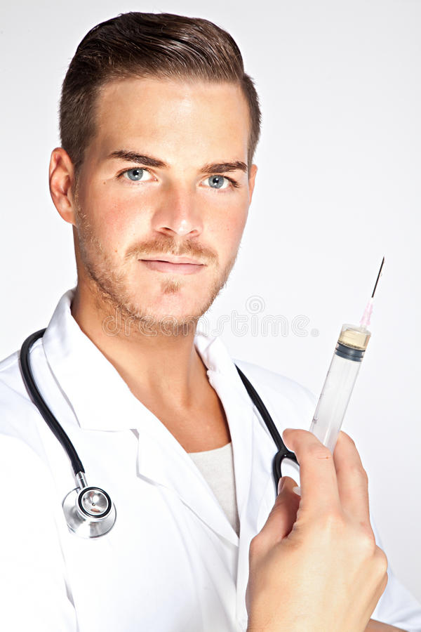 Young male doctor holding syringe with injection royalty free stock photos
