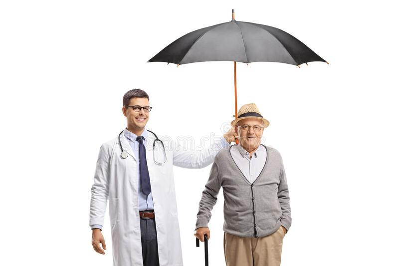 Young male doctor holding an umbrella over a senior man royalty free stock images