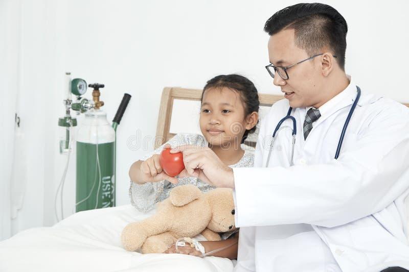Young male doctor pediatrician checking girl stock photos