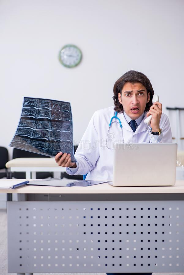 Young male doctor radiologist working in the clinic royalty free stock image