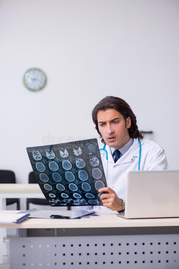 Young male doctor radiologist working in the clinic. The young male doctor radiologist working in the clinic royalty free stock photography