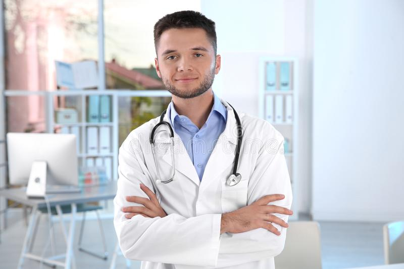 Young male doctor with stethoscope wearing white coat stock photography