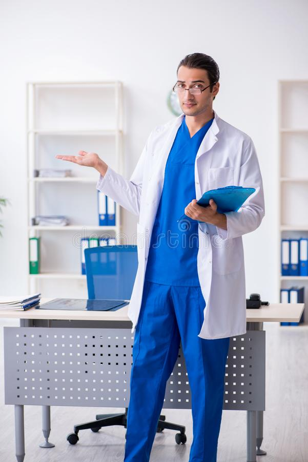 Young male doctor working in the clinic. The young male doctor working in the clinic stock photos