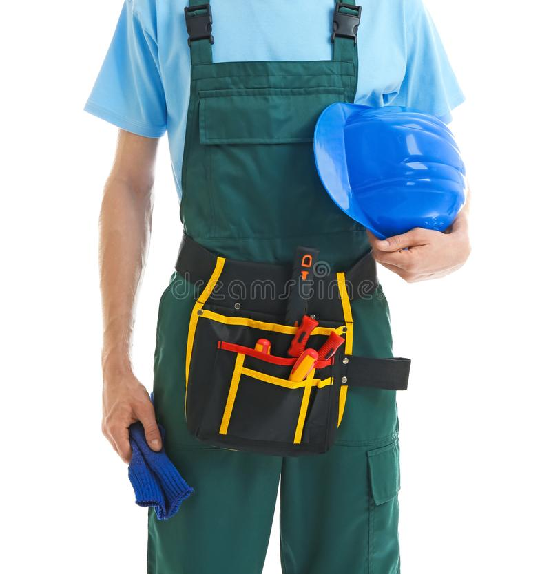 Young male electrician with hardhat on white background royalty free stock photography