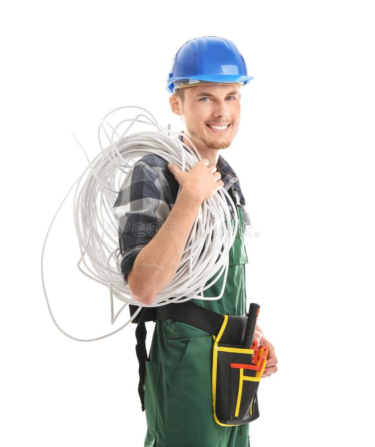 Young male electrician on white background stock image