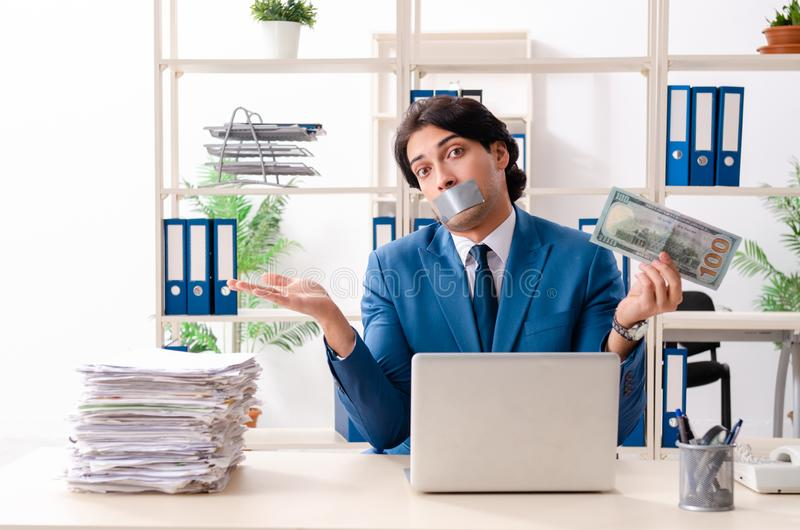 Young male employee with tape on the mouth stock image