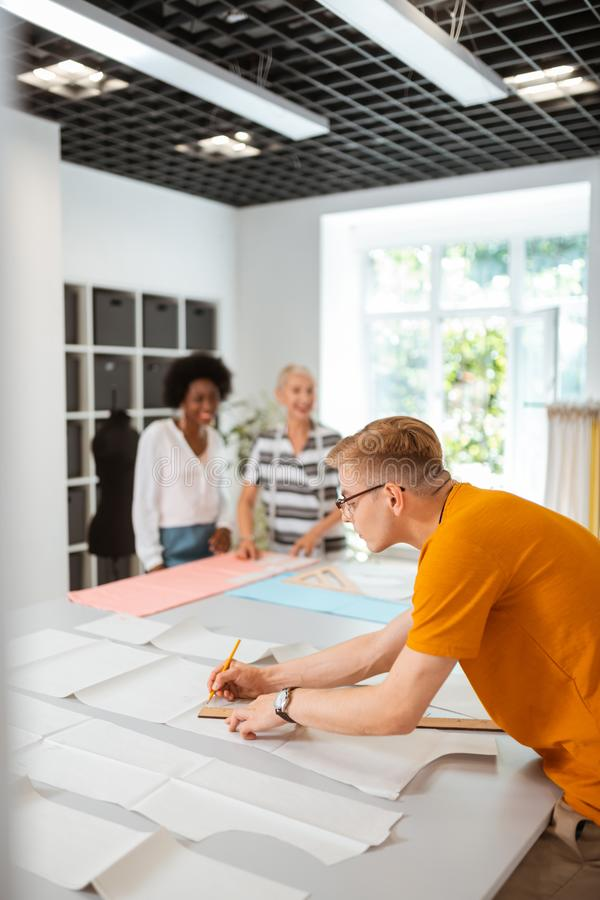 Young male fashion designer working in a studio stock photography