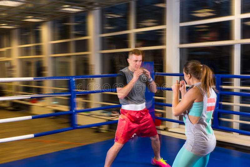 Young male and female in action practicing boxing stock images