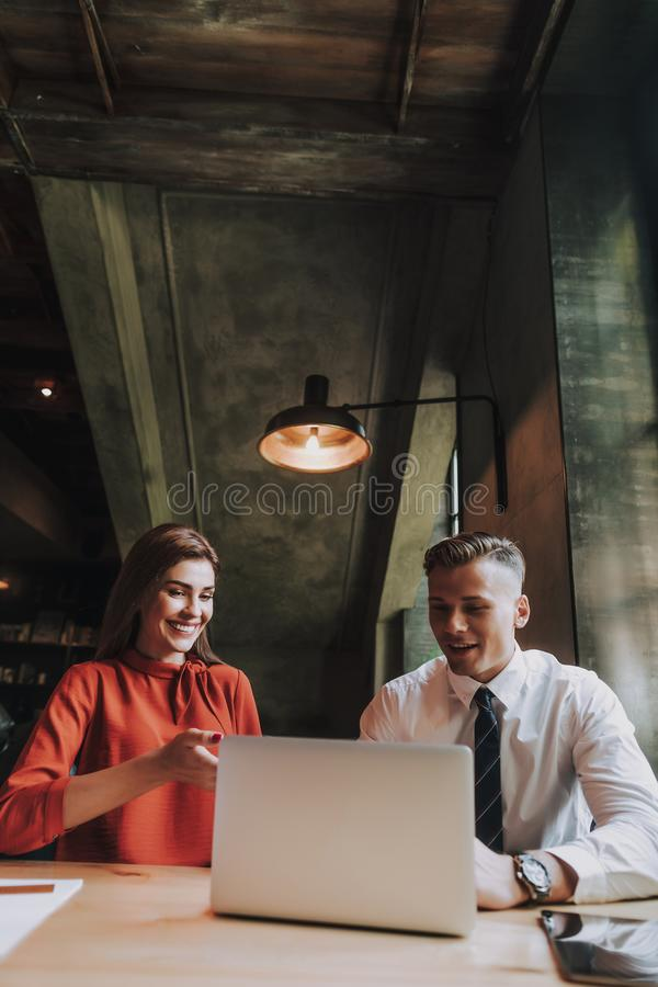 Young male and female colleagues working in office stock photo