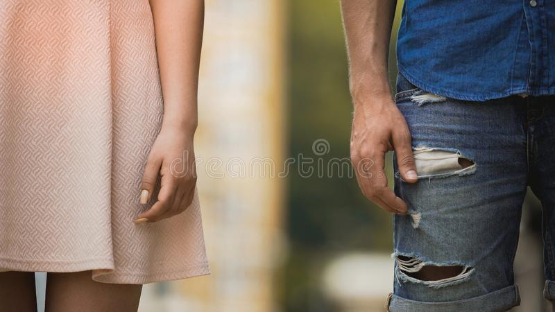 Young male and female standing next to each other, couple breaking up, closeup royalty free stock photo