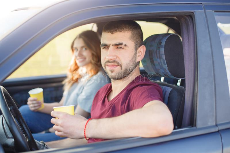 Young male and female travel by car, family trip, couple spend time together during vacation, man and woman stop at side of road stock photos