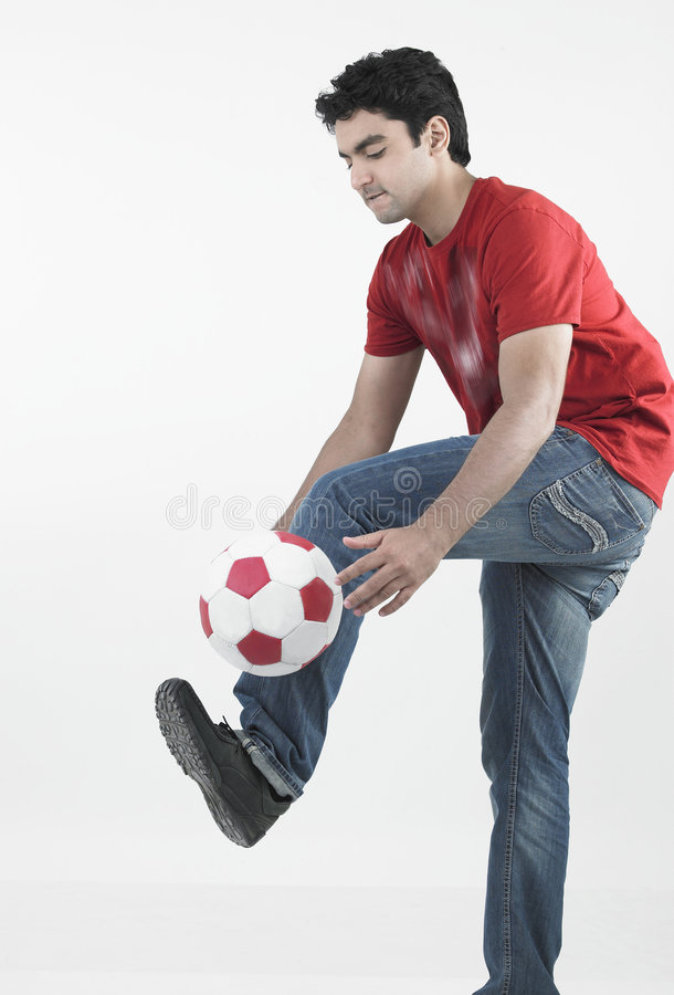 Young male footballer royalty free stock photography