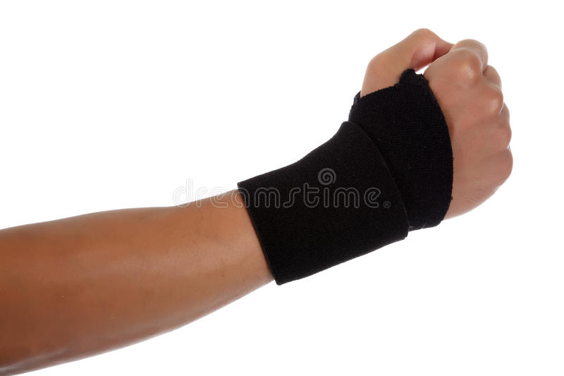 Young male hand, African American. Young African American male hand gesturing wearing blue neoprene wrist support. Studio shot. White background stock images