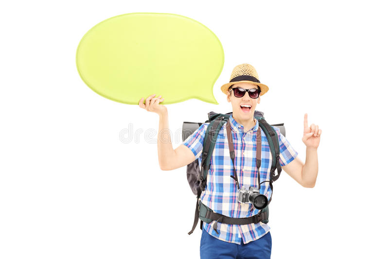 Young male hiker holding a speech bubble and gesturing with his
