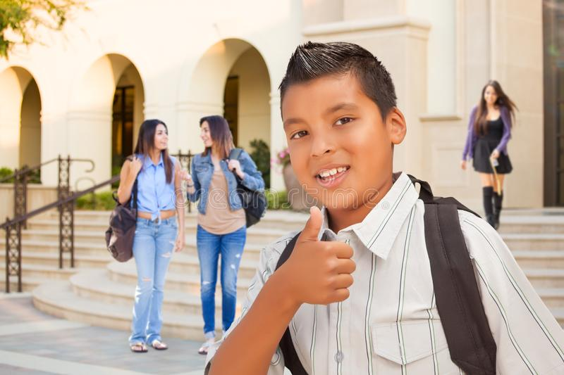 Young Male Hispanic Student Boy Gives Thumbs Up on Campus. Young Male Hispanic Student Boy with Thumbs Up on a School Campus royalty free stock photo
