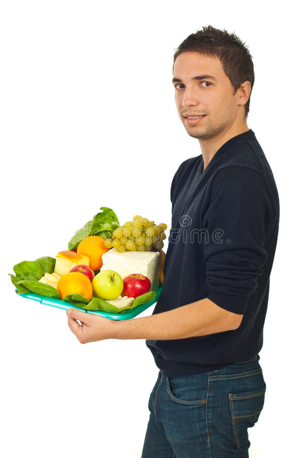 Young male holding healthy food stock image