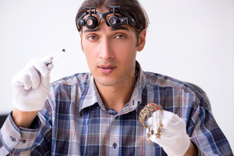 Young male jeweler at workshop royalty free stock images