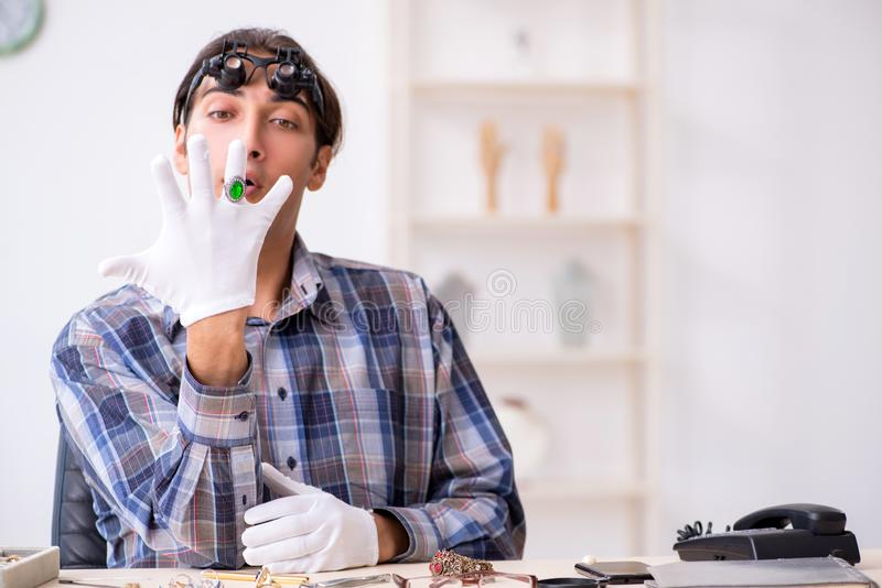 Young male jeweler at workshop royalty free stock photo