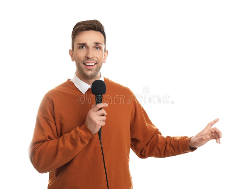 Young male journalist with microphone on background stock photo