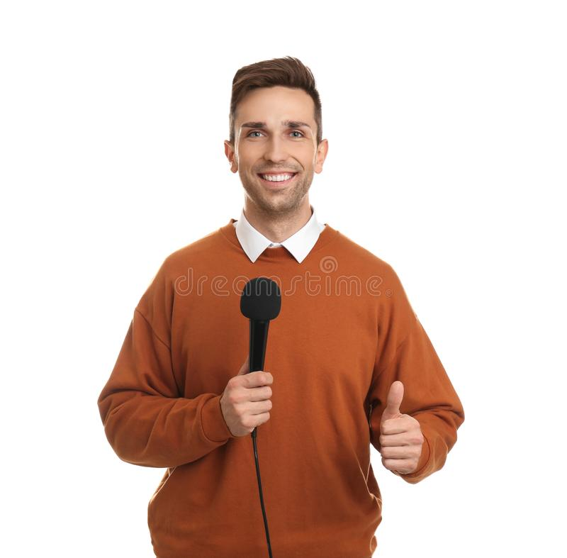 Young male journalist with microphone on background royalty free stock photos