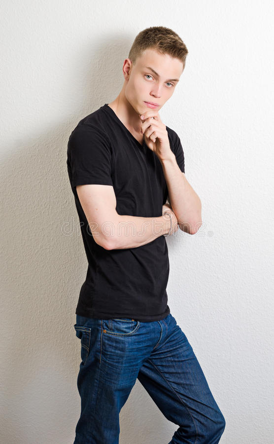 Young Male Leaning On Wall Portrait Stock Photo