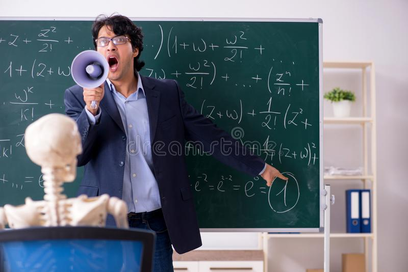 The young male math teacher and student skeleton royalty free stock images