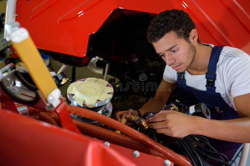 Young male mechanic at work stock photo
