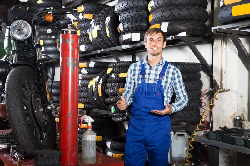 Young male mechanic working in auto repair shop royalty free stock photo