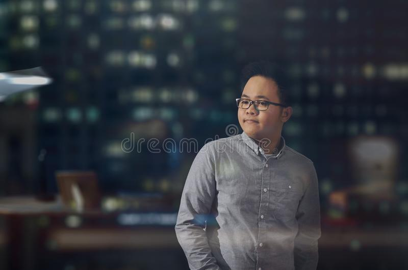Young male model with eye glasses looking at something. stock photo