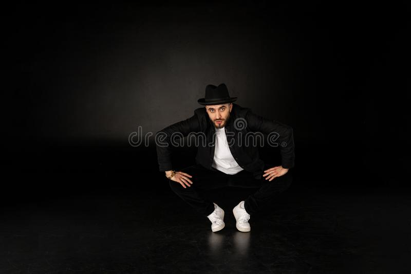 Young male modern dancer in black clothes and hat royalty free stock photos