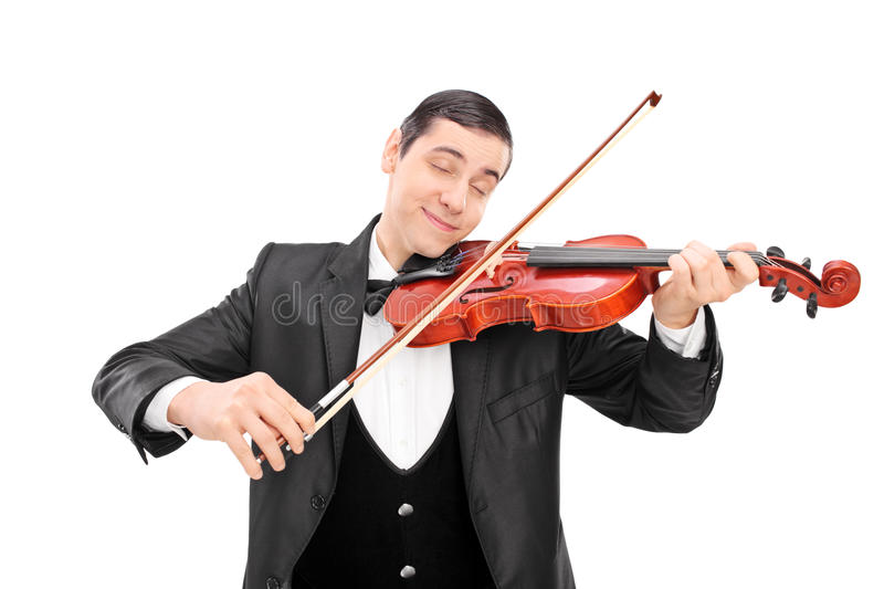 Young male musician playing an acoustic violin. With his eyes closed isolated on white background stock photography