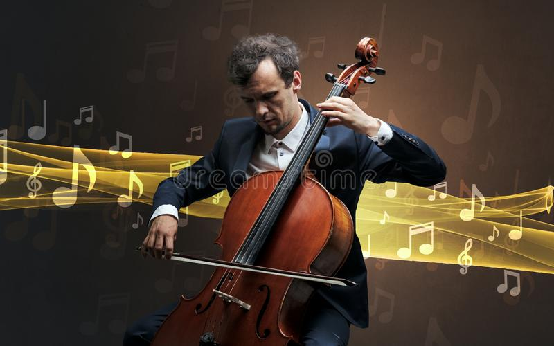 Musician playing on cello with notes around. Young male musician playing on his cello with musical notes around royalty free stock image